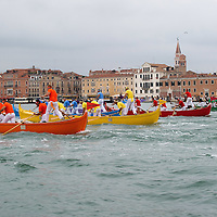 VENICE, ITALY - SEPTEMBER 04:  Rowers on traditional Venetian boats 'Caorline' take part in one of the races of the Historic Regata on September 4, 2011 in Venice, Italy. The Historic Regata is the most popular boat race on the Gran Canal for locals and tourists alike.