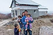 Rudo (25) and his wife Maria (22) with their daughters and son Kevin in front of their new home. The family is among those who joined the micro loan program in Rankovce to built themselves their own house with the support of the NGO ETP Slovakia. Self-construction helps to demolish stereotyped views about people from socially excluded communities, whom the majority population regards as abusers of social benefits, socially dependent, incapable, passive and constantly reliant upon state assistance. The approach gives people the opportunity to take care of themselves.