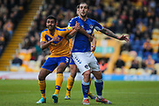 Malvind Benning of Mansfield Town and Urko Vera of Oldham Athletic during the EFL Sky Bet League 2 match between Mansfield Town and Oldham Athletic at the One Call Stadium, Mansfield, England on 12 October 2019.