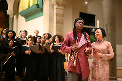 "Hannibal Lokumbe honors Dr. Kim Phúc during a concert that includes Lokumbe's composition Children of the Fire, at the Philadelphia Episcopal Cathedral in West Philadelphia, on Saturday. Dr. Phúc is the subject of the iconic 1972 ""Napalm Girl"" Pulitzer Prize-wining photograph by now-retired Associated Press photographer Nick Ut."