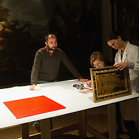 PADOVA, ITALY - APRIL 13:  Technicians and curator check Crucifixion  by Guariento which will be on display on April 13, 2011 in Padova, Italy. The Guariento exhibition will be open from April 16th until July 31st in the renovated Foundation Cariparo in Piazza del Duomo.