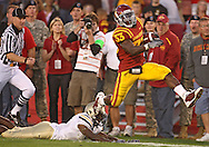 September 26, 2009: Iowa State running back Alexander Robinson (33) gets by a diving Army cornerback Mario Hill (1) on his way to a 68 yard touchdown run during the first half of the Iowa State Cyclones' 31-10 win over the Army Black Knights at Jack Trice Stadium in Ames, Iowa on September 26, 2009.