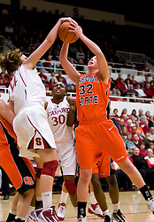 February 20, 2010; Stanford, CA, USA;  Stanford Cardinal forward Kayla Pedersen (14) battles with Oregon St. Beavers forward Kirsten Tilleman (32) for a rebound during the first half at Maples Pavilion. Stanford defeated Oregon State 82-48.