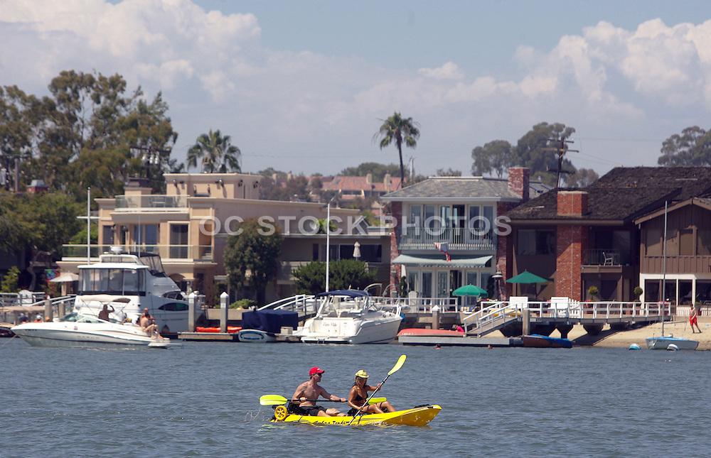 Couple Kayaking In Newport Harbor