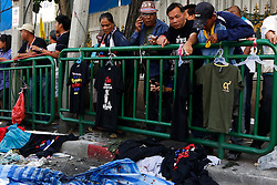 © Licensed to London News Pictures. 19/01/2014. Onlookers look at the scene of the grenade attack .The grenade attack has reportedly injured 28 people at the protest site at the Victory Monument in Bangkok Thailand. Anti-government protesters launch 'Bangkok Shutdown', blocking major intersections in the heart of the capital, as part of their bid to oust the government of Prime Minister Yingluck Shinawatra ahead of elections scheduled to take place on February 2. Photo credit : Asanka Brendon Ratnayake/LNP