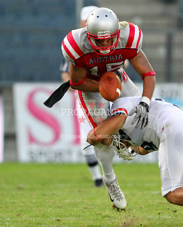 13.07.2011, UPC Arena, Graz, AUT, American Football WM 2011, Group B, Austria (AUT) vs France (FRA), im Bild fumble from Armando Ponce de Leon (Austria, #15, WR) after a hard tackle from Steve Delaval (France, #4, REC )  // during the American Football World Championship 2011 Group B game, Austria vs France, at UPC Arena, Graz, 2011-07-13, EXPA Pictures © 2011, PhotoCredit: EXPA/ T. Haumer