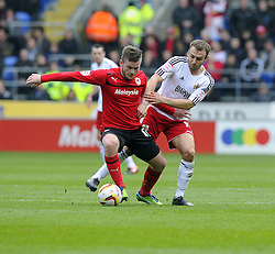 Cardiff City's Aron Gunnarsson battles for the ball with Bristol City's Liam Kelly - Photo mandatory by-line: Joe Meredith/JMP - Tel: Mobile: 07966 386802 16/02/2013 - SPORT - FOOTBALL - Cardiff City Stadium - Cardiff -  Cardiff City V Bristol City - Npower Championship