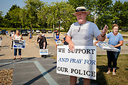 "08 AUGUST 2020 - WEST DES MOINES, IOWA: TOM WICKERSHAM leads a prayer for police officers and law enforcement in the parking lot of the West Des Moines Law Enforcement Center. About 100 people gathered at the West Des Moines Law Enforcement Center to rally in support of law enforcement. The rally was organized by ""Uplifting Our Police,"" a local organization that supports law enforcement. They rallied at Des Moines Police headquarters in July. They are planning similar rallies at police stations in the Des Moines metropolitan area.       PHOTO BY JACK KURTZ"