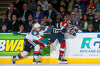KELOWNA, CANADA - MARCH 8: Colten Martin #8 of the Kelowna Rockets checks Lucas Nickles #9 of the Tri City Americans at the boards during second period on March 8, 2014 at Prospera Place in Kelowna, British Columbia, Canada.   (Photo by Marissa Baecker/Getty Images)  *** Local Caption *** Colten Martin; Lucas Nickles;