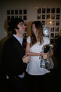 Noel Gallagher and Sara Macdonald, Exhibition of photographs by NME photographer Lawrence Watson. Studio 2. Redchurch St. London. 26 April 2007.  -DO NOT ARCHIVE-© Copyright Photograph by Dafydd Jones. 248 Clapham Rd. London SW9 0PZ. Tel 0207 820 0771. www.dafjones.com.
