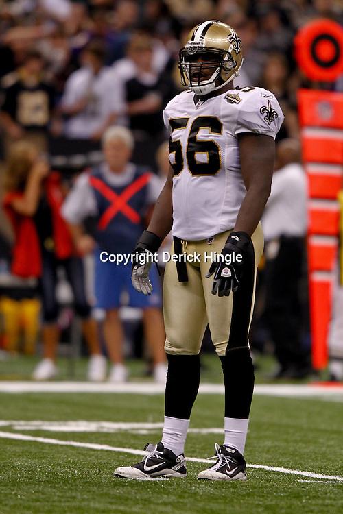 September 9, 2010; New Orleans, LA, USA;  New Orleans Saints linebacker Jo-Lonn Dunbar (56) on the field during the NFL Kickoff season opener at the Louisiana Superdome. The New Orleans Saints defeated the Minnesota Vikings 14-9.  Mandatory Credit: Derick E. Hingle