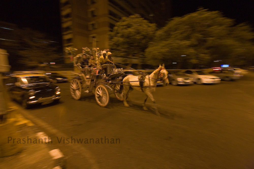 A horse tonga (carraige) takes tourists around at night in the Colaba area of Mumbai, India, February 8, 2008. Prashanth Vishwanathan\ATLAS PRESS