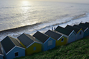 © Licensed to London News Pictures. 30/11/2013. Southwold, UK Deserted beach huts on the seafront. Crashing waves on the seafront in Southwold, Suffolk today, 30 November 2013. Photo credit : Stephen Simpson/LNP