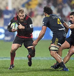 Crusaders Owen Franks, left, looks to take the ball forward as Highlanders Jackson Hemopo lines up a tackle in the Super Rugby quarter final match, AMI Stadium, Christchurch, New Zealand, July 22 2017.  Credit:SNPA / Adam Binns ** NO ARCHIVING**
