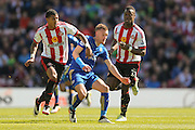 Sunderland defender Patrick Van Aanholt (3)  and Leicester City forward Jamie Vardy (9)  during the Barclays Premier League match between Sunderland and Leicester City at the Stadium Of Light, Sunderland, England on 10 April 2016. Photo by Simon Davies.