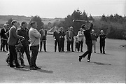 Irish Dunlop Golf Tournament at Tramore, Co. Waterford. J. Craddock, Foxrock, watches as his partner H.F. Boyle plays his second shot down the fairway in the second round. Boyle finished his first round in 66..19.08.1967