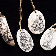 Modern scrimshaw, sperm whale teeth, Kingdom of Tonga.