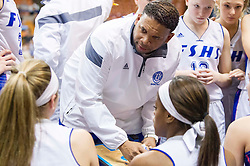 Fairmont Senior head coach Corey Hines talks to his team during a timeout against Bridgeport during a first round game at the Charleston Civic Center.