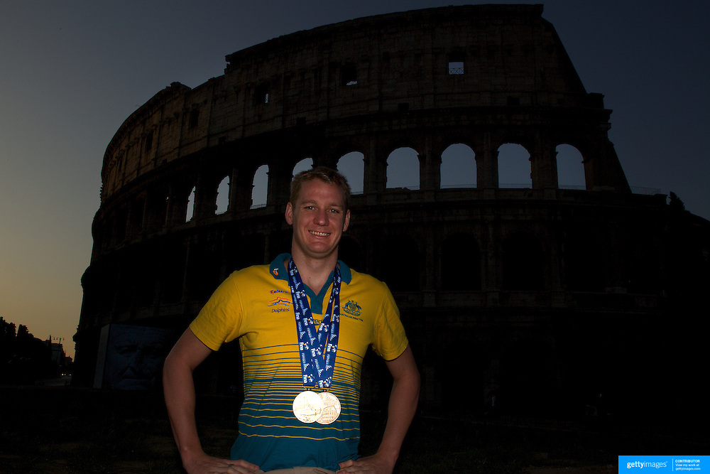 Australian Gold medal winner Brenton Rickard during a 6am photo shoot outside the Coloseum in Rome, Italy on  Monday, August 3, 2009. Photo Tim Clayton.