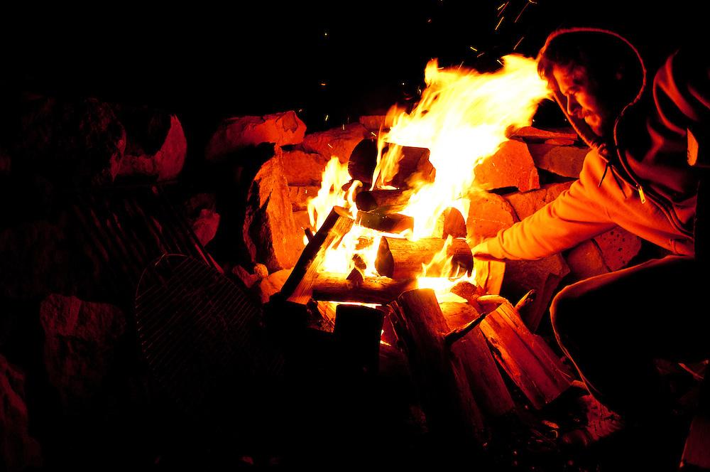 My friend Sam fixing a fire at his cabin near Cle Ellum, Washington.