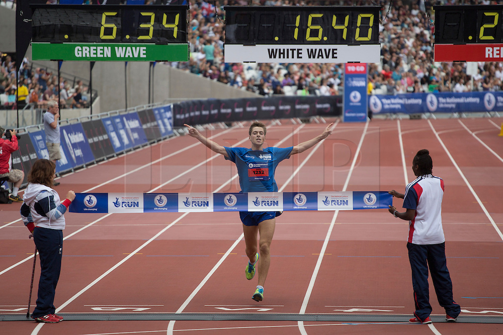 © licensed to London News Pictures. London, UK 21/07/2013. Alex Cornwell winning The National Lottery Anniversary Run at the The Stadium at Queen Elizabeth Olympic Park on Sunday, 21 July 2013 as the stadium open its doors to the public for the first time since London 2012. Paula Radcliffe, Sir Chris Hoy and Victoria Pendleton also took part at the event to support 12,500 runners. Photo credit: Tolga Akmen/LNP