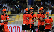 Perth Scorchers players during match 4 of the Karbonn Smart Champions League T20 (CLT20) 2013  between The Highveld Lions and the Perth Scorchers held at the Sardar Patel Stadium, Ahmedabad on the 23rd September 2013<br /> <br /> Photo by Vipin Pawar-CLT20-SPORTZPICS  <br /> <br /> Use of this image is subject to the terms and conditions as outlined by the CLT20. These terms can be found by following this link:<br /> <br /> http://sportzpics.photoshelter.com/image/I0000NmDchxxGVv4