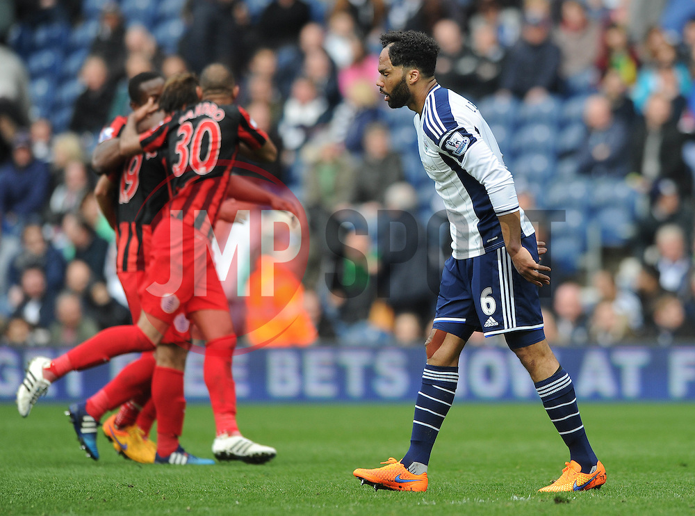 West Bromwich Albion's Joleon Lescott cuts a dejected figure as QPR celebrate - Photo mandatory by-line: Dougie Allward/JMP - Mobile: 07966 386802 - 04/04/2015 - SPORT - Football - West Bromwich - The Hawthorns - West Bromwich Albion v QPR - Barclays Premier League