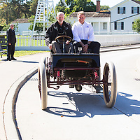 Henry Ford III taking a ride in the 1901 Sweepstakes, Henry Ford's first race car at the 115th Anniversary of Sweepstakes in Greenfield Village.