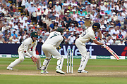 The ball goes for four byes off the pads of Chris Woakes of England during the International Test Match 2019 match between England and Australia at Edgbaston, Birmingham, United Kingdom on 3 August 2019.