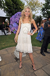NOELLE RENO at The Ralph Lauren Sony Ericsson WTA Tour Pre-Wimbledon Party hosted by Richard Branson at The Roof Gardens on June 18, 2009