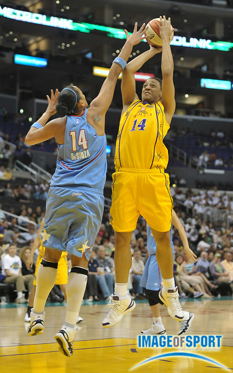 May 30, 2010; Los Angeles, CA, USA; Los Angeles Sparks forward Lindsay Wisdom-Hylton is defended by Atlanta Dream center Erika de Souza in the first half at the Staples Center. The Dream defeated the Sparks 101-82.