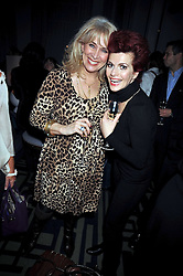 Left to right, CAROLE MALONE and CLEO ROCCOS at a party to celebrate the publication of 'In Bed With' held at the Artesian Bar,The Langham Hotel, 1c Portland Placeon 11th February 2009.