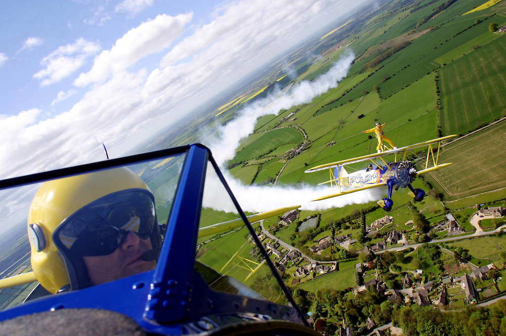 Jonathan Thompson stands on the Utterly Butterly wingwalking plane. photo by Mark Chilvers. 8/5/03