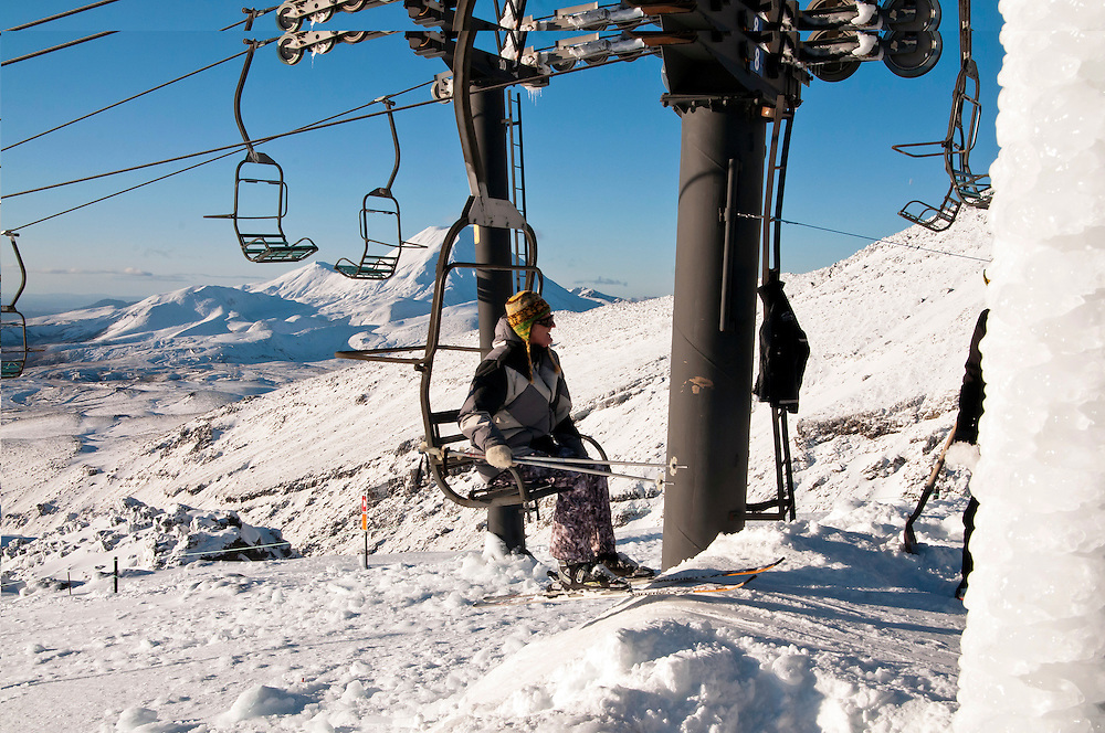 A skier prepares to dismount from the chairlift for a run on the Rock Garden at Whakapapa, Ruapehu, New Zealand,  Friday, June 29, 2012, with Ngaruahoe and Tongariro mountains snow covered in the background. Credit:SNPA / Malcolm Pullman.