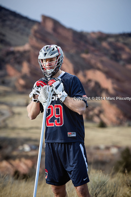 SHOT 2/22/14 5:05:01 PM - Denver Outlaws and Team USA defenseman Lee Zink poses for a portrait with Red Rocks and the foothills just outside of Denver, Co. in the background. Zink was named the 2012 Major League Lacrosse Defensive Player of the Year. When Zink grew up in Darien, Conn., and started his lacrosse career in sixth grade, he knew defense would be his calling card from the beginning. Zink will be playing in Denver this summer in the 2014 FIL World Lacrosse Championships.<br /> (Photo by Marc Piscotty / &copy; 2014)