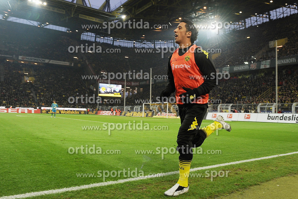 "28.01.2012, Signal Iduna Park, Dortmund, GER, 1. FBL, Borussia Dortmund vs 1899 Hoffenheim, 19. Spieltag, im Bild Lucas Barrios (Dortmund #18) wird zum Spiel gerufen // during the football match of the german ""Bundesliga"", 19th round, between GER, 1. FBL, Borussia Dortmund and 1899 Hoffenheim, at the Signal Iduna Park, Dortmund, Germany on 2012/01/28. EXPA Pictures © 2012, PhotoCredit: EXPA/ Eibner/ Ulrich Roth..***** ATTENTION - OUT OF GER *****"