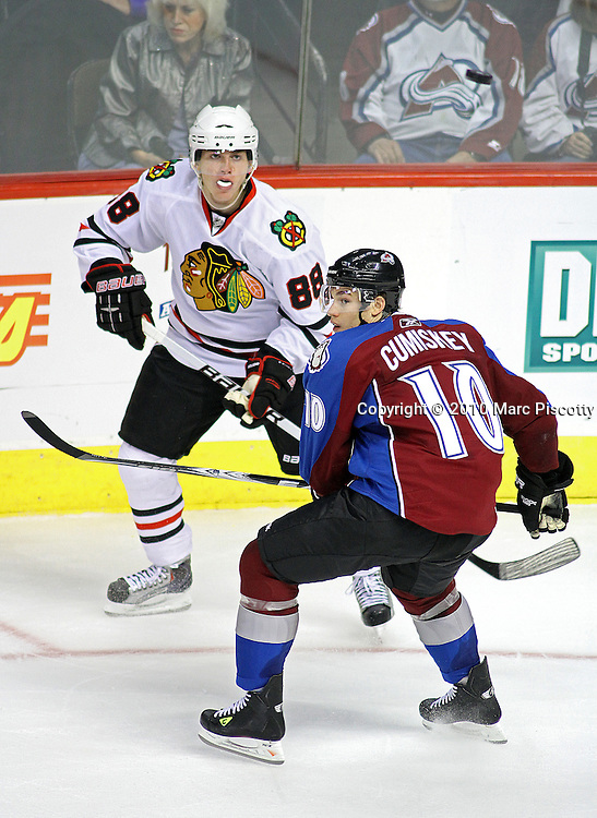 DENVER, CO - OCTOBER 7:  Patrick Kane (#88) of the Chicago Blackhawks flips the puck over the head of Kyle Cumiskey (#10) during both team's season openers at the Pepsi Center on October 7, 2010 in Denver, Colorado. (Photo by Marc Piscotty / © 2010)