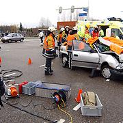 Ongeval met beknelling Randweg Huizen