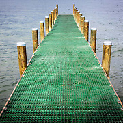 Dru Point, Waterfront boat ramp pier, empty as the weather keeps the boaters out of the water, Margate, Tasmania, Australia
