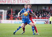 Notts County Forward Jonathan Stead and Crawley Town Defender Sonny Bradley fight for the ball during the Sky Bet League 2 match between Crawley Town and Notts County at the Checkatrade.com Stadium, Crawley, England on 16 January 2016. Photo by David Charbit.