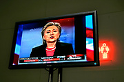 Las Vegas, Nevada, USA, 20080115: MSNBC hosts a debate between the Democratic Presidential Hopefuls at the Cashman Center.<br /> A sign for the female restroom behind a monitor showing Hillary Clinton during the debate.