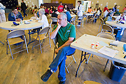 08 DECEMBER 2010 - PHOENIX, AZ: STEVE HOLLINGSWORTH, from Phoenix, AZ, waits to see a doctor at a Mission of Mercy mobile clinic in Phoenix, AZ, Wednesday, Dec. 8. Mission of Mercy has been providing free medical help for people in the Phoenix area since 1997. In the last two years, as the Arizona economy continued its recessionary slide, patient load at the clinics has more than doubled. Mission of Mercy, which relies on voluntary medical help and financial donations, recently acquired another mobile clinic so they could expand their reach into suburban areas they previously had not served. Mission of Mercy has provided free medical help to more than 43,000 patients in the Phoenix area since 1997.     PHOTO BY JACK KURTZ