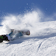 Charlotte van Gils, The Netherlands, crashes during the Snowboard Slopestyle Ladies competition at Snow Park, New Zealand during the Winter Games. Wanaka, New Zealand, 21st August 2011. Photo Tim Clayton