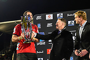 Milton Samios of Investec Australia hands Sam Whitelock the Super Rugby Trophy with Scott Robertson Coach during the Super Rugby Final, Crusaders V Lions, AMI Stadium, Christchurch, New Zealand, 4th August 2018.Copyright photo: John Davidson / www.photosport.nz