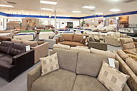 Seating furniture and mattress displayed in store