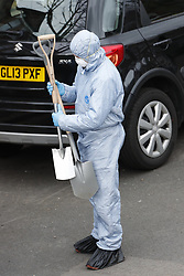© Licensed to London News Pictures. 07/03/2019. London, UK. Forensics officers carry spades as they work at a property in Kew, West London, where the body of a woman was discovered by police in a shallow grave. Laureline Garcia-Bertaux, 34, from Richmond, was reported missing after she did not turn up for work on Monday, 4 March. . Photo credit: Peter Macdiarmid/LNP