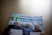 A magazine of Foxconn in Pardubice, Czech Republic. Foxconn Technology Group, is a multinational electronics contract manufacturing company headquartered in New Taipei, Taiwan. Foxconn is the world's largest electronics contractor manufacturer, and the third-largest information technology company by revenue.