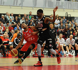 Bristol Flyers' Dwayne Lautier-Ogunleye challenges for the ball with Leicester Riders TrayVonn Wright - Photo mandatory by-line: Dougie Allward/JMP - Mobile: 07966 386802 - 13/03/2015 - SPORT - Basketball - Bristol - SGS Wise Campus - Bristol Flyers v Leicester Riders - British Basketball League