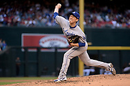 Apr 22, 2017; Phoenix, AZ, USA; Los Angeles Dodgers starting pitcher Kenta Maeda (18) delivers a pitch in the fourth inning against the Arizona Diamondbacks at Chase Field. Mandatory Credit: Jennifer Stewart-USA TODAY Sports