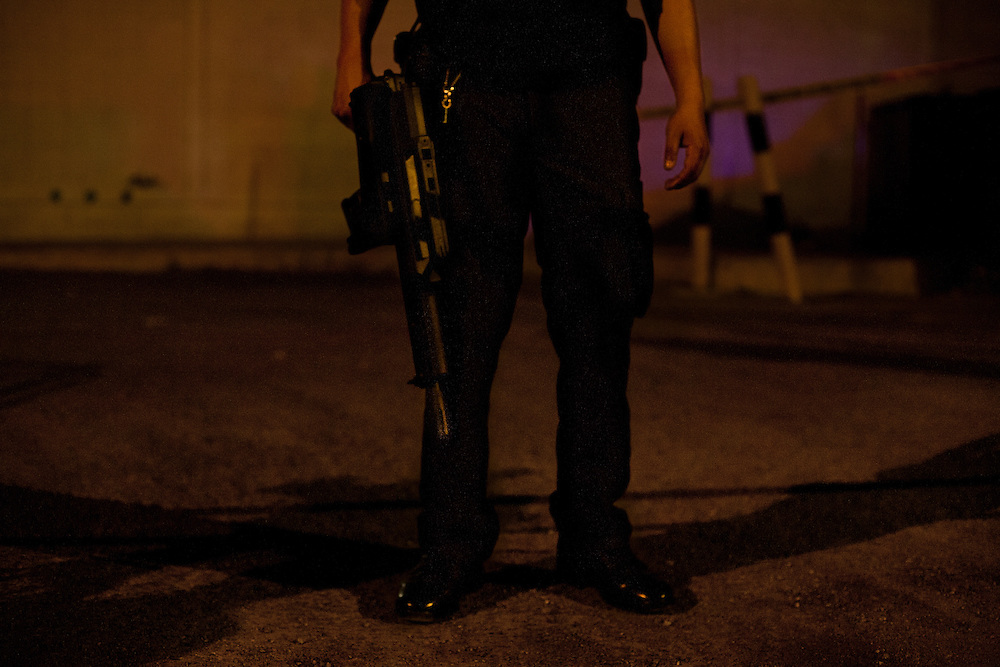 A Chihuahua State Police officer stands guard at the scene of an execution in May in Ciudad Juarez, Mexico less than five minutes from the United States border.